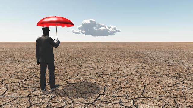 man-in-desert-with-umbrella-and-single-cloud-bruce-rolff